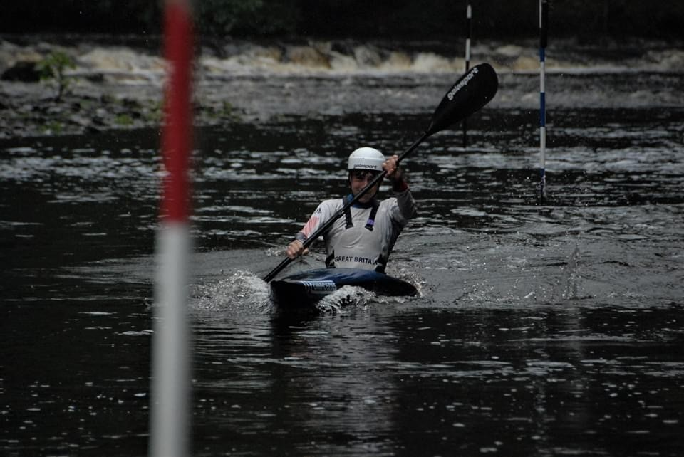 Eddie competing in canoe slalom